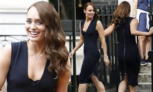 Laura Haddock flashes a hint of cleavage while filming